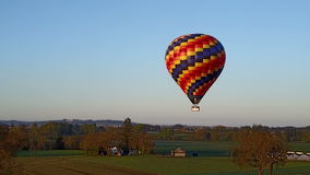 Hot air balloon flying over the farm