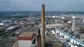 Aerial video of an industrial power plant in Massachusetts 4k