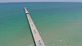 Aerial video of Lauderdale by the Sea fishing pier stock video footage