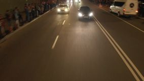 Aerial video of the Male gives start for drag racing on the street of the city. Racing speed cars in evening stock video