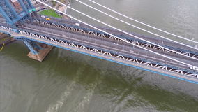 Aerial video Manhattan Bridge. Aerial video of a boat traveling under the Manhattan Bridge stock video footage