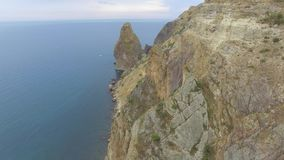 Aerial video of a married couple on the edge of beautiful cliffs at Cape Fiolent. stock video