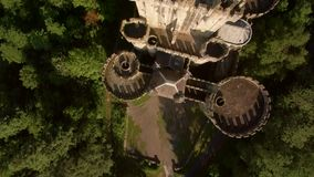 Aerial video of medieval tower in forest of rural spain stock footage