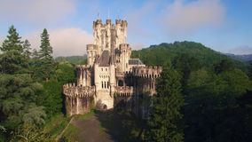 Aerial video of medieval tower in forest of rural spain stock video footage