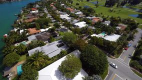 Aerial video Miami Beach golf course homes. 4k aerial video of Miami Beach houses on a golf course and waterfront stock footage