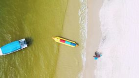Aerial view of motorcycle passing by the beach stock footage