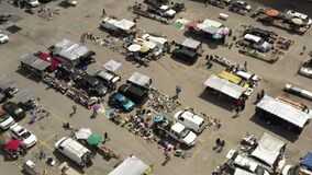 Aerial video people shopping at flea market