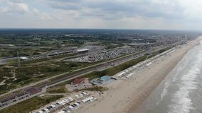 Aerial video of racing track and beach view at Zandvoort in the Netherlands. Aerial 4k stabilized video of racing track and beach view at Zandvoort in the stock footage