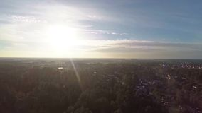 Aerial video of rural landside in winsen germany near hannover hanover. On direct sun rising up with look to forest stock video footage