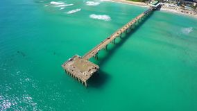 Aerial video of Sunny Isles Beach fishing pier. 4k aerial video of the Sunny Isles Beach fishing pier stock video
