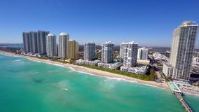 Aerial video of Sunny Isles Beach fishing pier. 4k aerial video of the Sunny Isles Beach fishing pier stock footage
