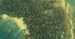 Aerial video top view of small island during sunset. Aerial video top view of small island off the coast of Thailand during sunset stock video footage