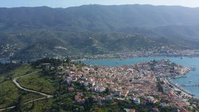 Aerial video view of Poros Greece. Sunny day in Greek island. Bay sea ships and yachts. Tourist destination stock video