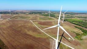 aerial Videodrehflug über Windgeneratoren bei Costa Vicentina Sagres stock video footage