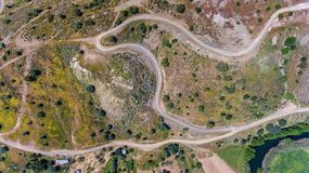 Aerial. Videography of drone, field roads near the dam Odeleite. Portugal. Videography of drone, field roads near the dam Odeleite. Portugal Royalty Free Stock Photos