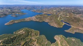 Aerial. Videography of drone, reservoir dam Odeleite. Portugal. Aerial. Videography of the drone, reservoir dam Odeleite. Portugal Royalty Free Stock Image