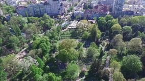 Aerial videography spring park, woods. On a sunny day with views of the city stock video footage