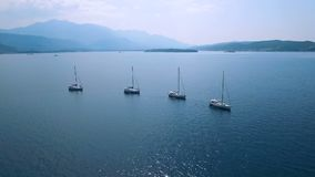 aerial Vier Yachten ausgerichtet auf adriatischem Meer stock video footage