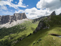 Aerial Viev of Dolomite Mountains. Blu sky, white clouds, green grass, italy Stock Image