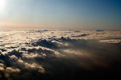 Aerial view above a blanket of clouds Stock Images