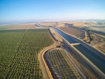 Aerial view above California aqueduct. Running through almond plantations and cultivated fields, drone shoot of farmland landscape Royalty Free Stock Photography
