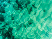 Aerial view above the Ocean, rocks and beach Royalty Free Stock Photography