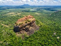 Aerial view from above of Sigiriya or the Lion Rock, an ancient fortress, palace with terracesin Dambulla, Sri Lanka. stock photo
