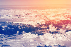 Aerial view above snowy Alps mountains Stock Photography