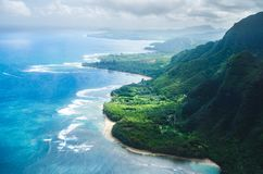 Aerial view of the abrupt and green Napali Coast in Kauai, US. Kauai is Hawaii`s fourth largest island and is somes called the Garden Island, which is an royalty free stock image