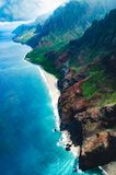 Aerial view of the abrupt and green Napali Coast in Kauai, US. Kauai is Hawaii`s fourth largest island and is somes called the Garden Island, which is an stock photos