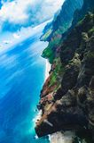Aerial view of the abrupt and green Napali Coast in Kauai, US. Kauai is Hawaii`s fourth largest island and is somes called the Garden Island, which is an stock images