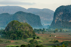 Aerial View across the Vinales Valley in Cuba. Morning twilight and fog. Fog at dawn in the Valley of Vinales in Pinar del Rio Stock Photo