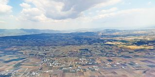Aerial view. View from an aeroplane,of coulds and small houses ,over athens greece,in a day of november Royalty Free Stock Image