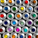 Aerial view of aerosol cans. Aerial view of neatly arranged aerosol cans with different colored nozzles stock images