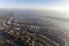 Newport Beach Harbor and Balboa Island Aerial. Aerial view of afternoon coastal fog and sunshine above Newport Beach and Balboa Island in Orange County royalty free stock photography