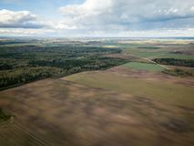 Aerial view of agriculture fields during nice sunny autumn day. Sky with heavy clouds. royalty free stock photography