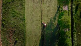 Aerial view agriculture machinery, traktor ride on day time working field tractor plow