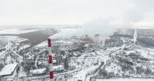 Aerial view: Air pollution from industrial plants. Pipes of a dirty factory emit smoke into the sky and atmosphere. Cause of globa. L warming stock footage