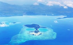 Aircraft view. Aerial view from aircraft flying in tropical island. Landscape from above royalty free stock photo