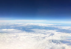 Aerial view from the airplane.Above the sky horizon.World explorer cover Royalty Free Stock Photos
