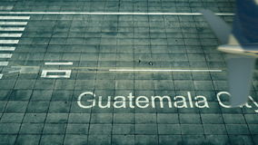 Aerial view of an airplane arriving to Guatemala City airport. Travel to Guatemala 3D rendering Stock Image