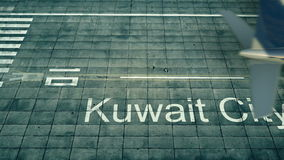 Aerial view of an airplane arriving to Kuwait City airport. Travel to Kuwait 3D rendering Royalty Free Stock Images