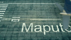 Aerial view of an airplane arriving to Maputo airport. Travel to Mozambique 3D rendering Stock Photos