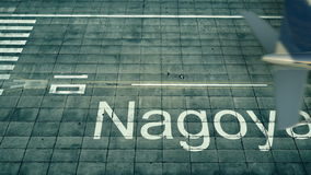 Aerial view of an airplane arriving to Nagoya airport. Travel to Japan 3D rendering Stock Photos