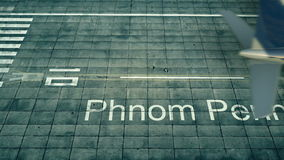 Aerial view of an airplane arriving to Phnom Penh airport. Travel to Cambodia 3D rendering Stock Photography