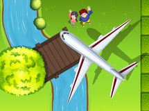 Aerial view of airplane flying over the park Royalty Free Stock Image