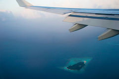 Aerial view from airplane on Maldives island with Plane wing. Photo of the Aerial view from airplane on Maldives island with Plane wing Royalty Free Stock Photography