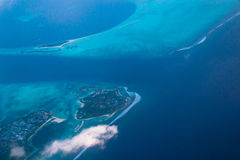 Aerial view from airplane on Maldives islands. Abstract color. Stock Images