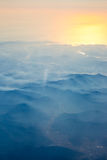 Aerial view from the an airplane at sunrise time Stock Images