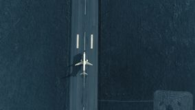 Aerial view of the airplane on take-off approach at the airport runway. top view
